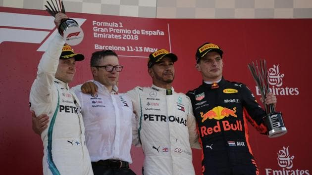 Winner Mercedes driver Lewis Hamilton of Britain, second from right, stands on the podium with second place Mercedes driver Valtteri Bottas of Finland, left and third place Red Bull driver Max Verstappen of the Netherlands, after the Spanish Formula One Grand Prix at the Barcelona Catalunya racetrack in Montmelo, Spain, on Sunday.(AP)