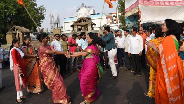 Party workers celebrating success of the early poll numbers at Dr Babasaheb Ambedkar chowk, Pimpri, on Sunday.(HT PHOTO)