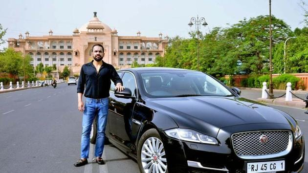 Rrahul Tanejaa with his Jaguar with premium number 1.(HT PHOTO)