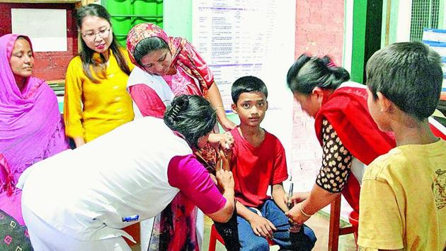 Nassir Hussain, 12, gets vaccinated against measles and rubella on May 12 at a primary health centre in Kwakta, Bishnupur district. The vaccination drive had to be extended in Manipur because of high refusals among Muslims following fake news.(Sanchita Sharma/HT Photo)