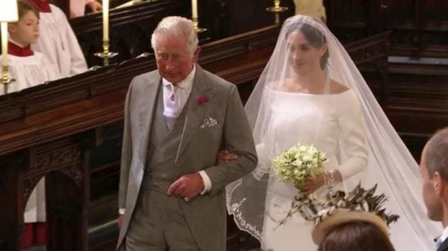 Meghan Markle walks down the aisle with Prince Charles for her wedding ceremony at St. George's Chapel in Windsor Castle in Windsor, near London, England.(AP)