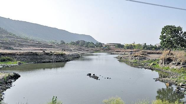 The pond at Sector 35 was cleaned by residents recently. The clean-up drive continued for an entire day and the trash collected was enough to fill two mini trucks.(Bachchan Kumar/Hindustan Times)