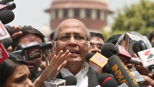Senior Congress leader and lawyer Abhishek Manu Singhvi speaks to the media after a Supreme Court hearing on the Karnataka issue, in New Delhi on Friday.(HT Photo)