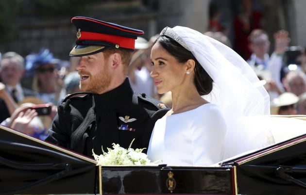 Britain's Prince Harry and Meghan Markle leave after their wedding ceremony at St. George's Chapel in Windsor Castle in Windsor, England on May 19, 2018.(AP)