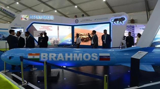 Visitors look at a display of DRDO BrahMos missile at the DefExpo 2018, a large defence exhibition showcasing military equipment, on the outskirts of Chennai on April 11, 2018.(AFP)
