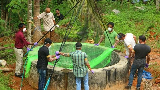 Animal Husbandry department and forest officials inspect a well to catch bats at Changaroth in Kozhikode in Kerala on May 21, 2018.(AFP Photo)