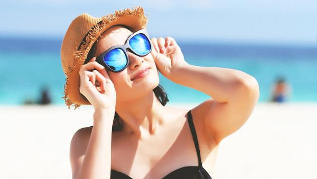 Apply a layer of sunscreen before stepping out.(iStockphoto)
