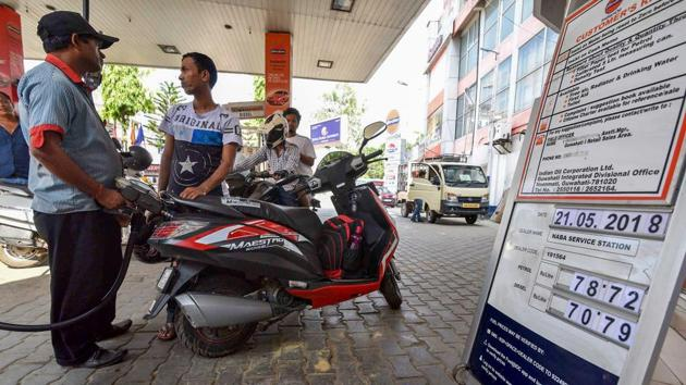 A view of a fuel station displaying the current fuel prices, in Guwahati, on Monday.(PTI Photo)