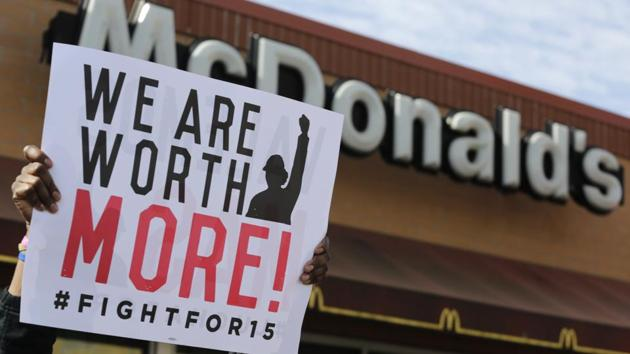 McDonald's workers and supporters rally outside a McDonald's in Chicago.(AP File Photo)