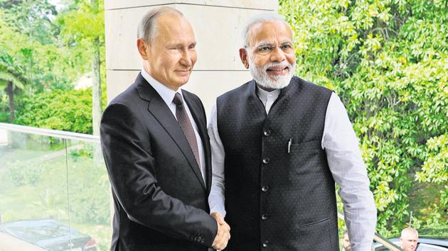 Prime Minister Narendra Modi with Russian President Vladimir Putin, during their meeting in the Bocharov Ruchei residence in the Black Sea resort of Sochi, Russia, May 21, 2018(AP)