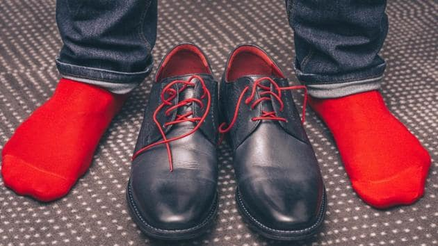 Socks style guide: If you are not well-versed with the art of wearing socks, classic black dress socks paired with a smart tuxedo and formal or brogue shoes will make you look classy and elegant.(Shutterstock)