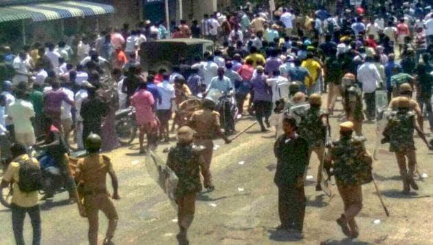 Police tackle agitators demanding the closure of Vedanta's Sterlite copper unit in Tuticorin on Tuesday.(PTI)