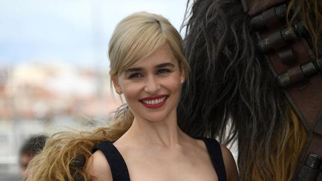 British actress Emilia Clarke (L) poses on May 15, 2018 with Chewbacca during a photocall for the film Solo : A Star Wars Story at the 71st edition of the Cannes Film Festival.(AFP)