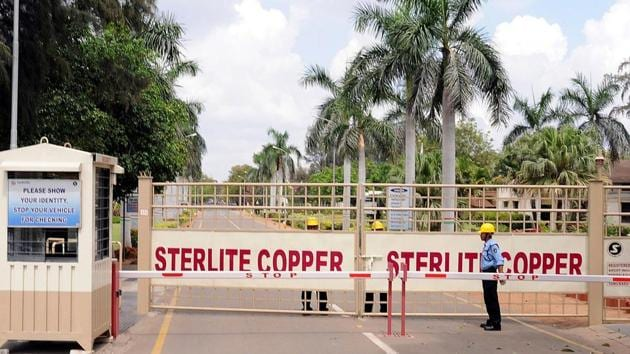 A private security guard stands in front of the main gate of Sterlite Industries Ltd's copper plant, a unit of London-based Vedanta Resources, in Tuticorin, on March 24, 2013.(REUTERS)