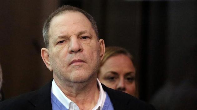 Film producer Harvey Weinstein stands inside Manhattan Criminal Court during his arraignment in Manhattan in New York.(REUTERS)