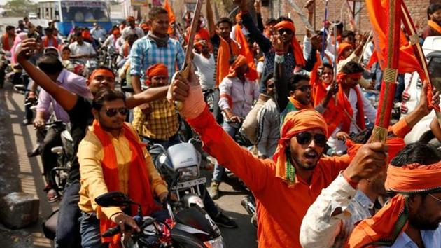 Hindu Yuva Vahini members take part in a rally in UP's Unnao in April 2017. The outfit froze its membership drive and dissolved the district units after receiving reports that office bearers were involved in unlawful activities.(Reuters File Photo)