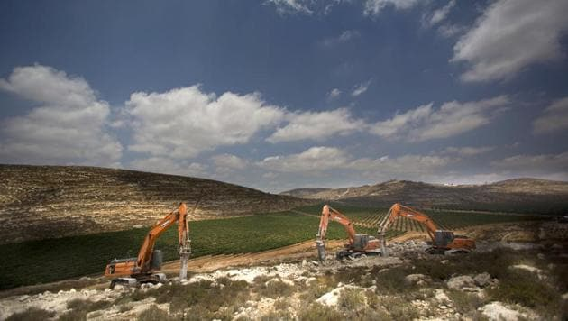 Diggers break ground for a new settlement near the Israeli settlement of Shilo, in the West Bank.(AP File Photo)