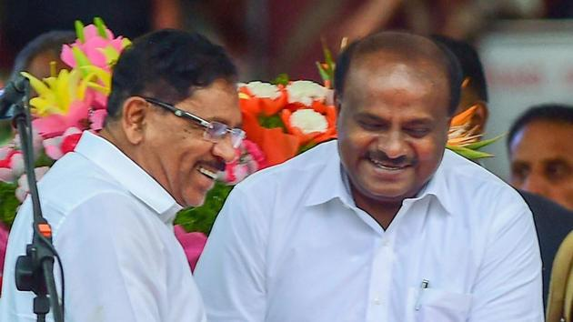 Karnataka chief minister and JD(S) leader HD Kumaraswamy greets deputy CM G Parameshwara after the oath-taking ceremony in Bengaluru.(PTI File Photo)