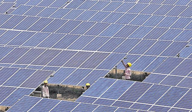 In Diu, large swathes of government land have been used to build solar parks. India is building 38 parks across 23 states to meet an ambitious target of generating 100 gigawatts of solar power by 2022.(Satyabrata Tripathy/HT Photo)