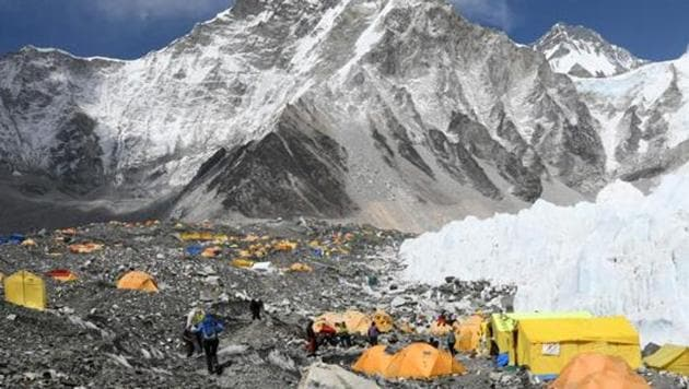 In this photograph taken on April 23, 2018, climbers and porters are seen by their tents at Everest base camp, some 140 kilometres northeast of Kathmandu.(AFP File Photo)