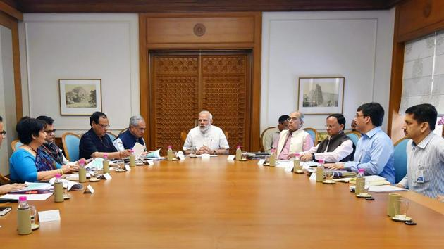 Prime Minister Narendra Modi reviews the preparations for the launch of a health scheme under Ayushman Bharat, in New Delhi.(PTI)