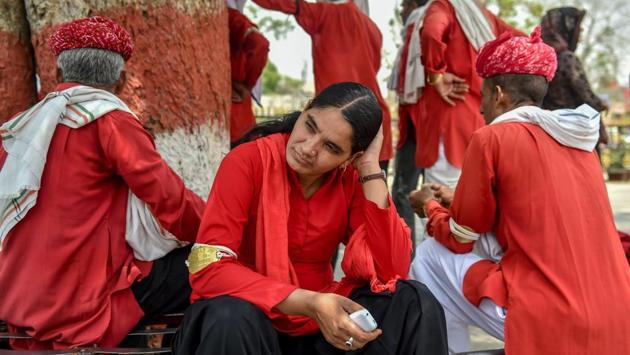 <p>Manju Devi looks on as she shares a relaxed moment with her male colleagues in Jaipur, Rajasthan on May 20, 2018. Devi stands tall in her fraternity, as the...
