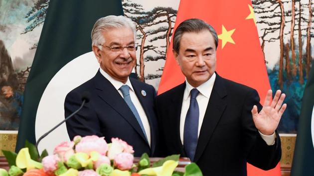 Pakistan's Foreign Minister Khawaja Muhammad Asif and Chinese State Councilor and Foreign Minister Wang Yi at a press conference at the Diaoyutai State Guest House in Beijing, China, April 23, 2018.(Reuters File Photo)