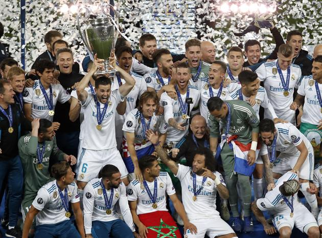 Real Madrid's Nacho lifts the trophy after winning the Champions League Final soccer match between Real Madrid and Liverpool at the Olimpiyskiy Stadium in Kiev, Ukraine.(AP Photo)