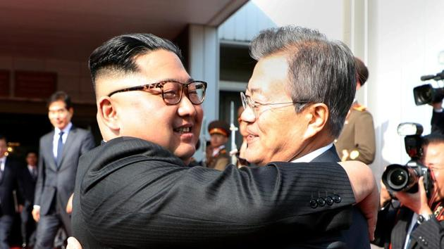 South Korean President Moon Jae-in (right) bids farewell to North Korean leader Kim Jong Un as he leaves after their summit at the truce village of Panmunjom, North Korea, on Saturday.(Reuters photo)