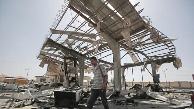 A Yemeni man walks on the rubble of a petrol station after it was hit by Saudi-led airstrikes in Sanaa, Yemen, Sunday, May 27, 2018.(AP)