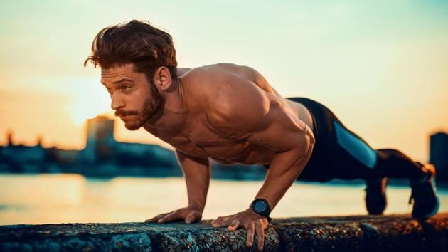 Want to lose weight without going to a gym? Try some basic exercises, like push ups, that do not require heavy gym equipments.(Shutterstock)