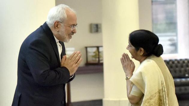 External affairs minister Sushma Swaraj greets Iran's foreign minister Mohammad Javad Zarif in New Delhi on Monday(Sonu Mehta/HT PHOTO)
