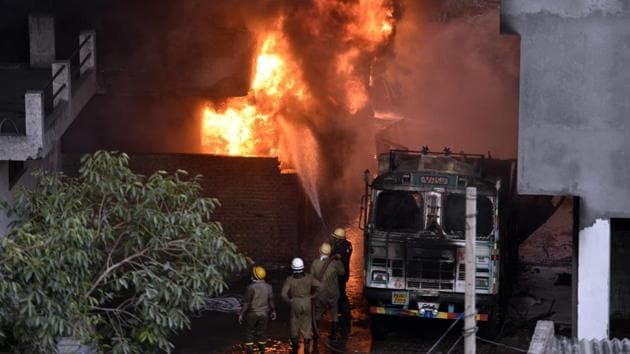 Firefighters attempt to douse a massive fire that broke out at a plastic and rubber warehouse near a school at south Delhi's Malviya Nagar in New Delhi.(Sanchit Khanna/HT Photo)