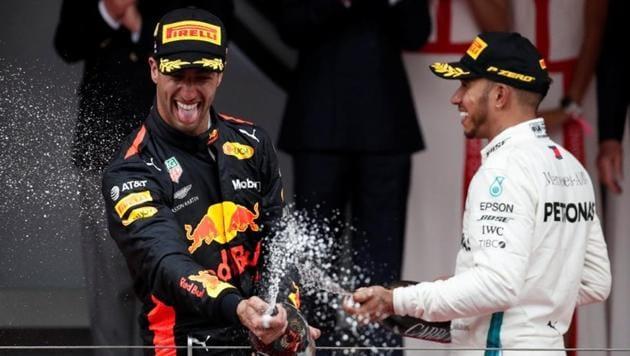 Red Bull's Daniel Ricciardo celebrates winning the Monaco Grand Prix in the Circuit de Monaco, Monte Carlo with Mercedes' Lewis Hamilton, who finished third, on May 27, 2018.(REUTERS)