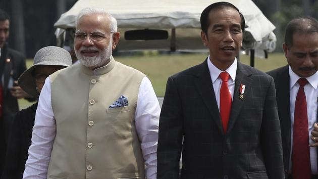 Prime Minister Narendra Modi,walks with Indonesian President Joko Widodo upon arrival at the National Monument Monas for an India-Indonesia kite exhibition in Jakarta, Indonesia, Wednesday 30, 2018.(AP)