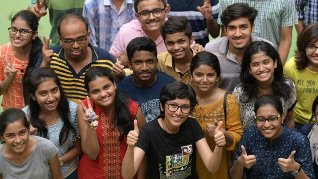 Students celebrate their success after HSC Class 12 results were declared on Wednesday.(Bachchan Kumar/HT)