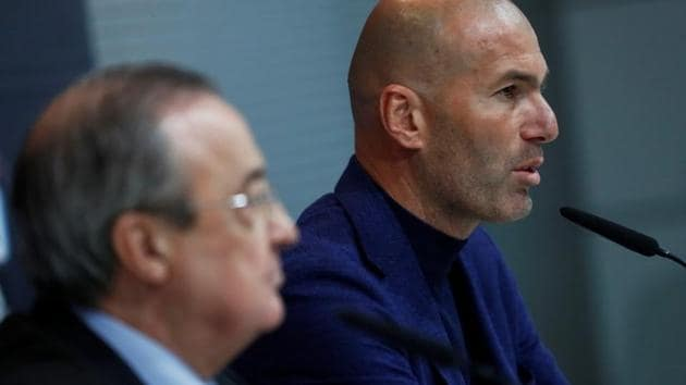 Zinedine Zidane announces his decision to step down as Real Madrid coach as club president Florentino Perez looks on in Madrid on Thursday.(REUTERS)