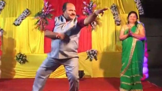 Sanjeev Shrivastava dances at a wedding in Gwalior on May 12. A stranger recorded Shrivastava's moves, making him an internet sensation.(WhatsApp video grab)
