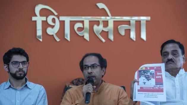 Shiv sSena chief Uddhav Thackeray with Yuva Sena chief Aditya Thackeray address a press conference at Sena Bhavan in Mumbai on Thursday.(Satish Bate/HT Photo)