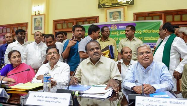 Karnataka chief minister HD Kumaraswamy, his deputy G Parameshwara and chief secretary Ratnaprabha (left) during a meeting with farmers on the issue of loan waivers, in Bengaluru.(PTI File Photo)