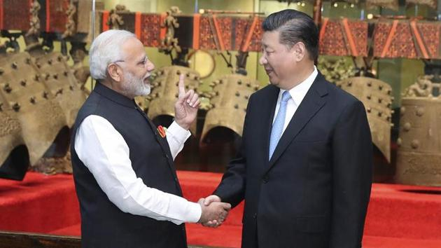 In this photo released by China's Xinhua News Agency, Indian Prime Minister Narendra Modi, left, shakes hands with Chinese President Xi Jinping as they visit an exhibition of cultural relics at the Hubei Provincial Museum in Wuhan in central China's Hubei Province on April 27, 2018.(AP File Photo)