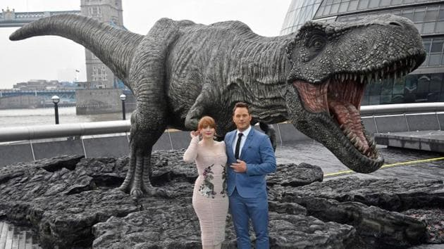 Cast members Chris Pratt and Bryce Dallas Howard pose in front of a model dinosaur during a photocall to promote the forthcoming film Jurassic World: Fallen Kingdom in London.(REUTERS)