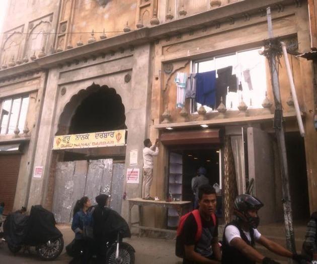 The Guru Nanak Durbar Gurdwara under reconstruction in the crowded Punjabi Lane of Bara Bazaar in Shillong.(HT Photo)