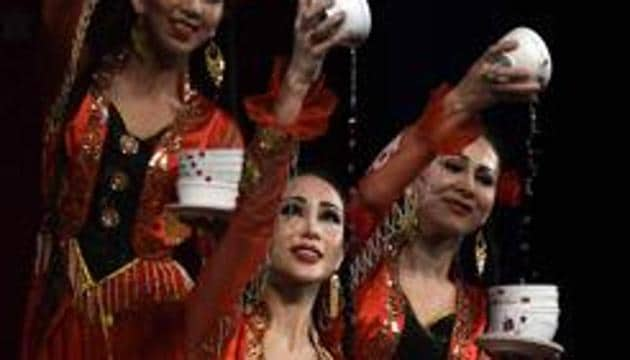 """Chinese Cultural show, """"Bowl Dance"""", to celebrate Chinese New Year 2017 performance by Xinjiang Art Theatre song and Dance troupe, in New Delhi.(HT File Photo)"""