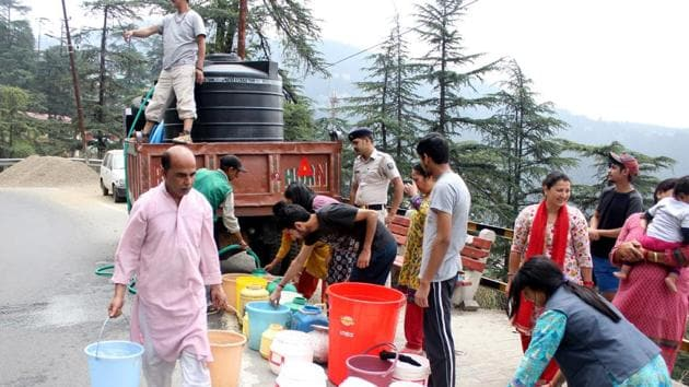People fill water from water tankers in Shimla, June 1(HT)