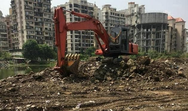 Pramod Patil, environment and forest officer, Cidco, said they cannot do anything because the pond is neither a wetland nor a natural body.(HT Photo)