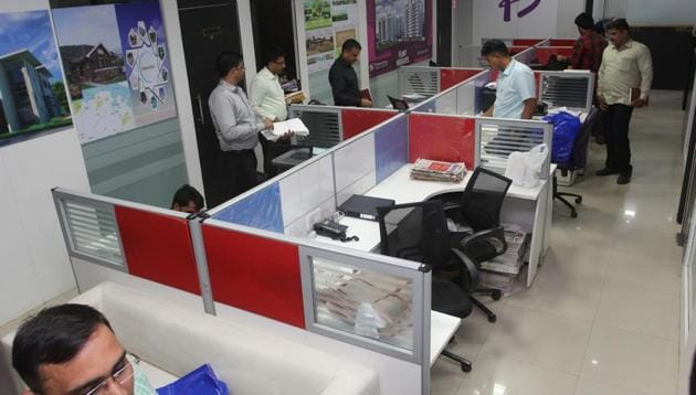 Officials raid the office of the Flinstone Group in Thane on Monday.(Praful Gangurde)