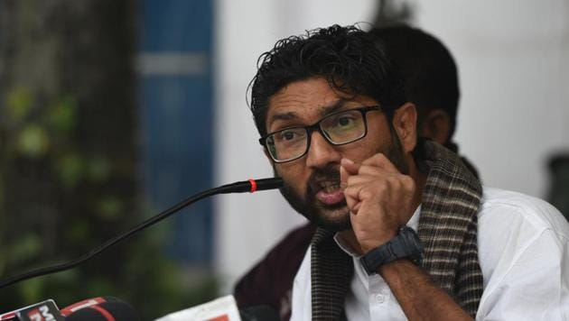 Jignesh Mevani, member of legislative assembly (MLA) from Gujarat, was booked for defamation and identity theft, for sharing a picture of Yogi Adityanath, chief minister of Uttar Pradesh, Sri Sri Ravi Shankar, self-proclaimed spiritual leader and Shefali Vaidya, a columnist from Pune.(HT FILE PHOTO)