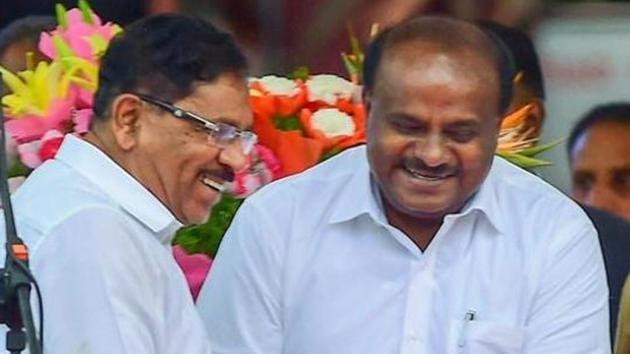 Karnataka chief minister HD Kumaraswamy greets deputy chief minister G Parameshwara after the oath-taking ceremony in Bengaluru on May 23, 2018.(PTI)