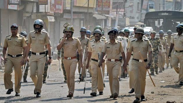 Police officials patrol streets after Dalits called for Maharashtra bandh to protest against Bhima Koregaon violence, at Sangli in Maharashtra.(PTI File Photo)